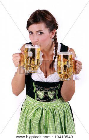 Female waitress tasting drinking beer