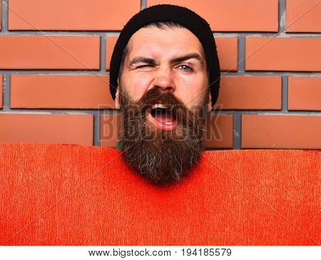 Bearded Brutal Caucasian Hipster With Red Paper Sheet