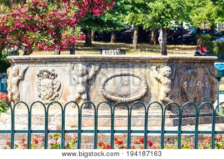 CORFU ISLAND, GREECE - JUNE 26, 2017: Little humans monument in park of Corfu island, Greece