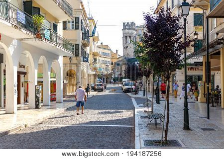 CORFU ISLAND, GREECE - JUNE 26, 2017: Big tourist street with people walking. Corfu city, Greece. Daylight view