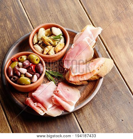 Tapas Of Salmon, Mussels, Jamon And Olives