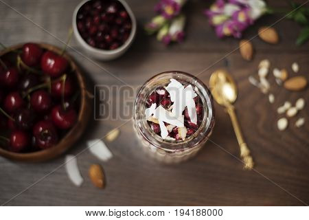 Overnight Chia Pudding With Chia Seeds, Oats, Pomegranate And Coconut Chips. Healthy Breakfast Conce