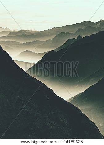 Spectacular Aerial View Of Mountain Silhouettes And Misty Valleys. Misty Awaking Of Beautiful Fairy
