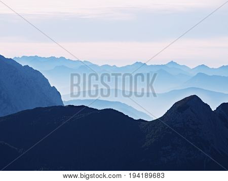 View Over High Sharp Mountain Peaks From Plane, Beautiful View. Fantastic Dreamy Sunrise