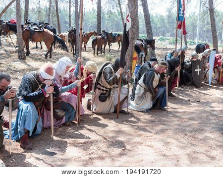 Tiberias Israel July 01 2017 : Participants in the reconstruction of Horns of Hattin battle in 1187 in the role of the Crusaders pray in the camp before the campaign near TIberias Israel