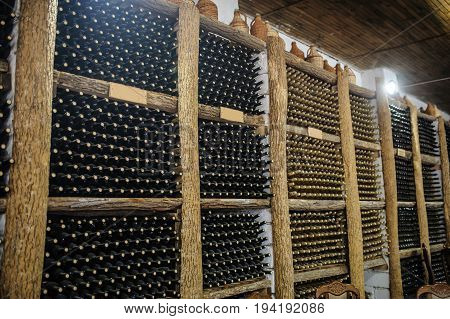 With Bottles On Wooden Shelves