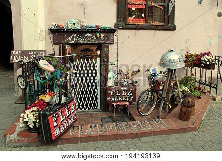 VILNIUS, LITHUANIA - JULY 20, 2015: Flea market shop with vintage goods in Old Town, Vilnius, Lithuania