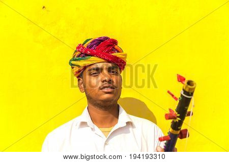 Young Indian playing traditional rajasthani music on the street of Jaipur, Rajasthan, India