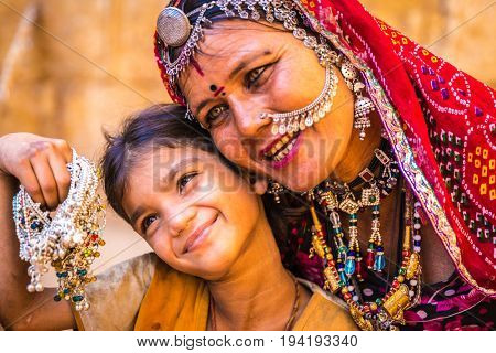 Mom and daughter in sari costume, India