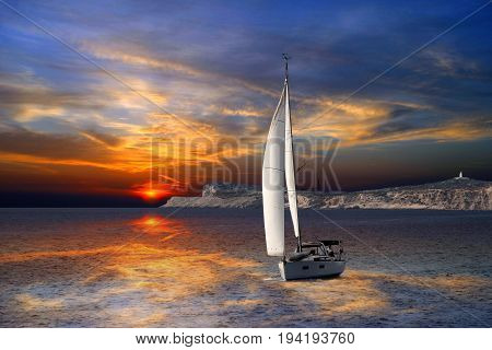 Sailboat Sailing on the Mediterranean sea during the sunset