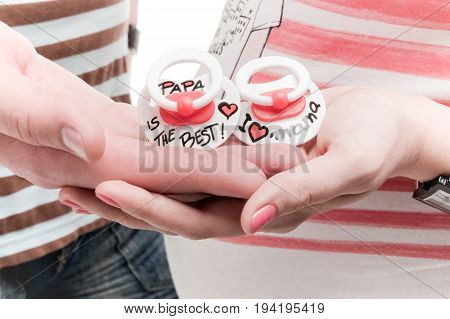 Baby's nipples in the hands of mom and dad