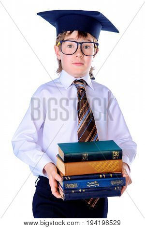 Young student boy in glasses and academic hat holds a stack of books. Educational concept. Isolated over white.