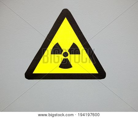 Ionizing radiation trefoil symbol painted on the metal surface. Radioactivity sign.