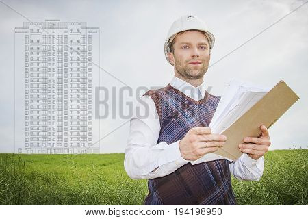 Engineer architect designer with drawings of object construction of apartment building. Architect on  background of blueprint for construction of apartment building.