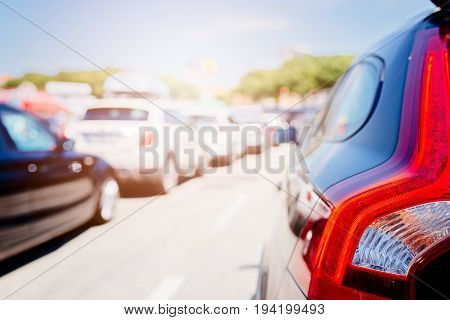 Cars stuck in traffic jam at sunny summer day