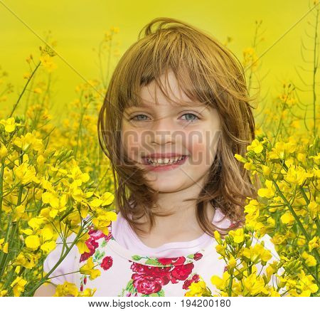 little girl on a field with colza