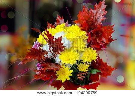 Autumn bouquet of yellow and orange flowers