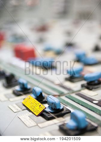 CHERNOBYL UKRAINE - OCTOBER 15 2015: Control panel at Chernobyl Nuclear Power Plant. Inscription on the yellow plate in Russian: Taken out of operation.