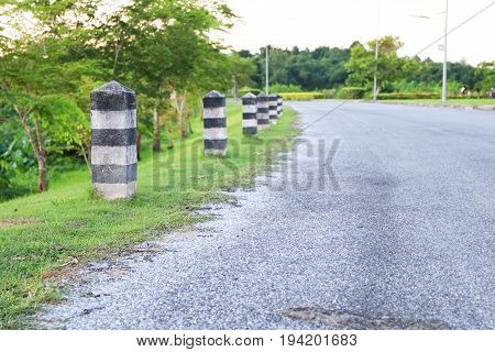 black and white painted milestone. in range roadside on white background