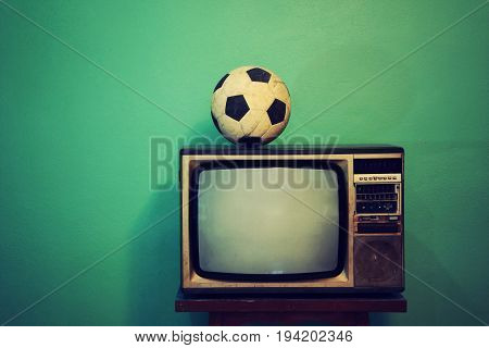 An old football on a retro TV vintage style