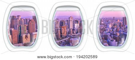 Three porthole frame windows on High-rise buildings in the middle of Osaka with spectacular sunset colors. Umeda district aerial view. Osaka cityscape, Japan.