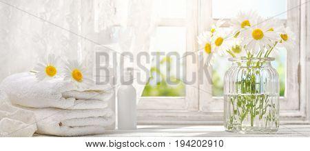 towel with daisy flowers near window