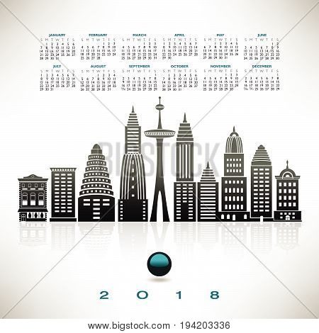 2018 calendar with a stylized cityscape on a plain background