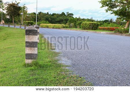 black and white painted milestone. in range roadside