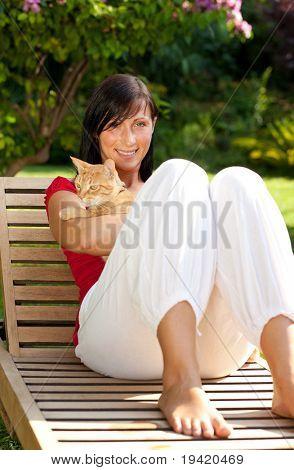 Pet loving anti allergy girl sitting on wooden garden chair