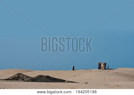 Sand Dunes In Desert With Bedouin And Nomad Tent