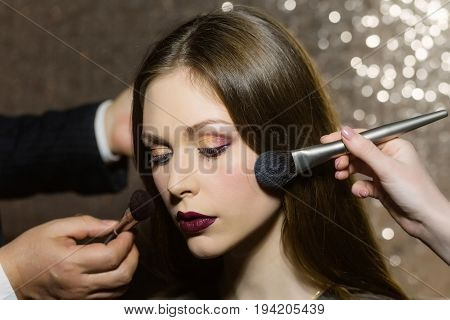 Woman Getting Powder On Face Skin With Two Brushes