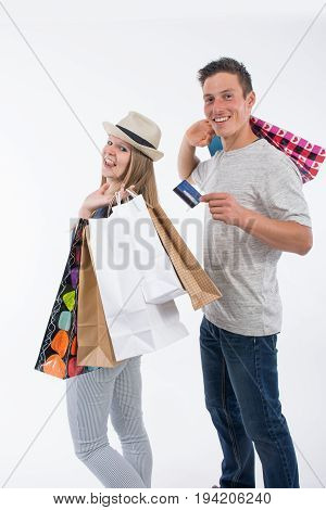 Young Happy Couple With Shopping Bags