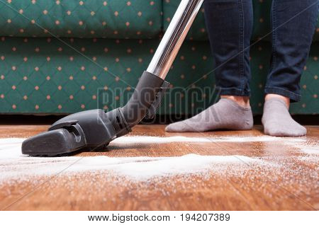 Close-up Of Cleaning Female Vacuuming Floor In House