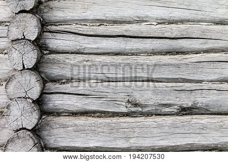 Background texture in the form of logs. The photo shows the wall of a Russian log cabin. Photo taken on a cloudy day.