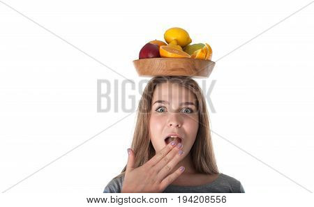 Portrait of young woman which is holding a wooden bowl with fruits: apples oranges lemon. Vitamins and healthy eating. Bright fruits on wooden bowl. Healthy eating.