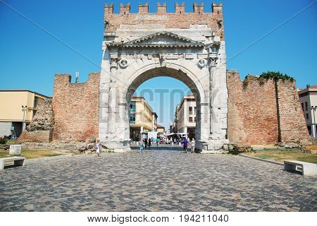 Rimini Italy - June 21 2017: the triumphal arch of Augustus in the central part of Rimini a resort town in Italy