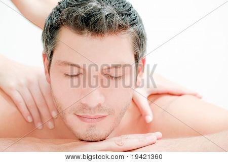 Caucasian handsome spa man getting wellbeing massage