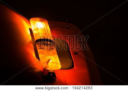Emergency light or Flashing beacon. Orange flashing and revolving light on top of a support and services vehicle.