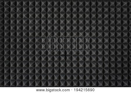 Soundproofing foam.Acoustic foam. Dark gray foam silencer