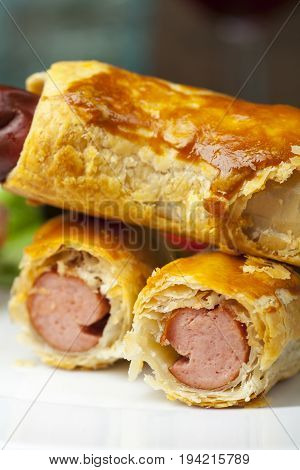 close up of franfurters in pastry with salad