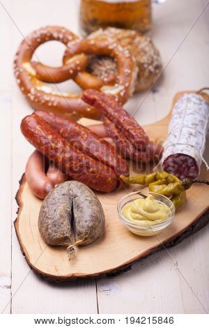 bavarian sausages on wood with beer and pretzel