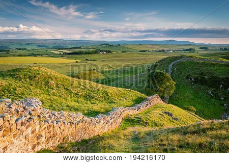Hadrian's Wall above Steel Rigg, which is a World Heritage Site in the beautiful Northumberland National Park. Popular with walkers along the Hadrian's Wall Path and Pennine Way