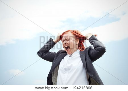Business Concept Of Success. Evil Woman Boss, In A Suit Tearing Her Hair Emotionally Reacts And Scre