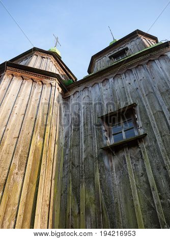 Ancient wooden church (XVIII century) from the Central Ukraine in the open-air Museum of Folk Architecture near Kyiv.