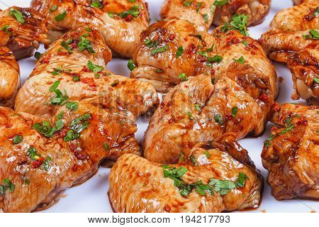 Close-up Of Marinated Raw Chicken Wings