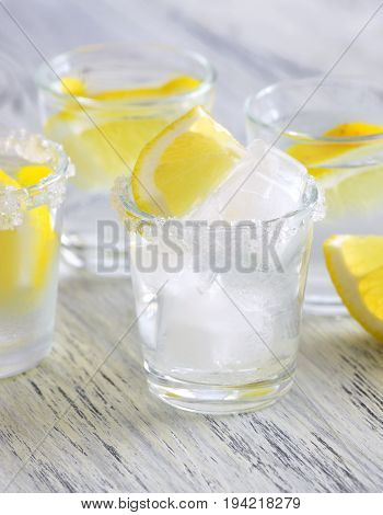 Cocktail with vodka and lemon. Vodka with ice. Selective focus
