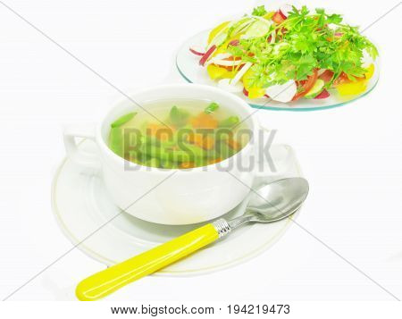 soup with haricot leguminous bean carrot and vegetable salad on background