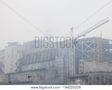 CHERNOBYL UKRAINE - OCTOBER 22 2015: Construction of New Safe Confinement (or New Shelter) at Chernobyl Nuclear Power Plant over the nuclear reactor destroyed by Chernobyl disaster in 1986.