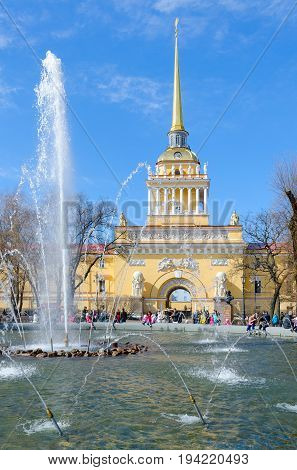 SAINT PETERSBURG RUSSIA - MAY 1 2017: Unknown people are resting by fountain near building of Main Admiralty St. Petersburg Russia