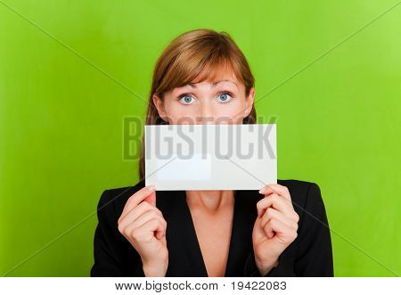 Businessperson holding writing being curious or sad